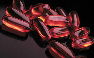 Reddish transparent pills